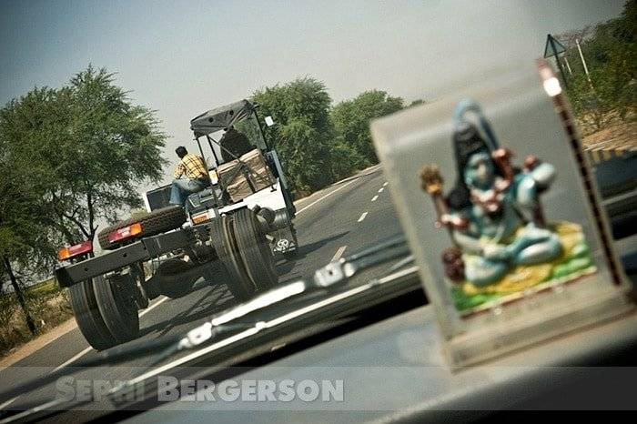 Half built trucks are common view on Indian roads. The chassis is manufactured by the truck manufacturer but the rest of the truck is made of wood and will be built and decorated individually