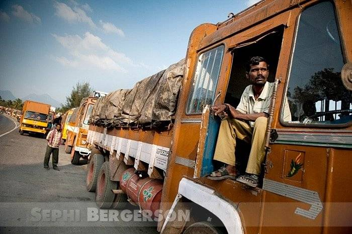 A long line of trucks wait their turn for checking at the notorious Walayar check post between Tamil Nadu and Kerala in south India