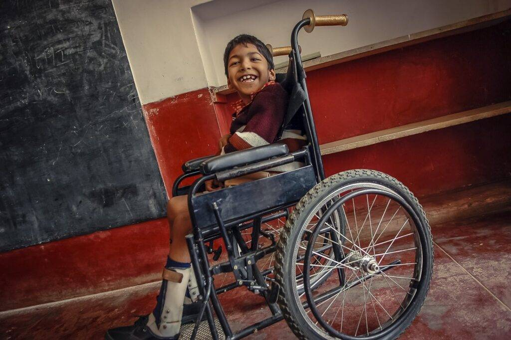 Monsoor (7) sitting in his wheel chair in the class room at APD school in Bangalore. He suffers from cerebral palsy and needs a wheel chair to move about.
